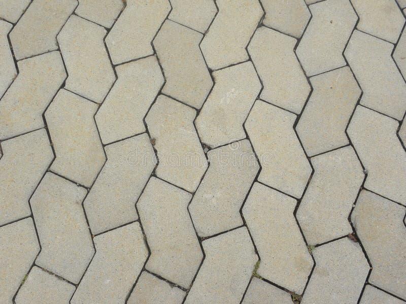 Piso concreto con el embaldosado hexagonal foto de archivo libre de regalías