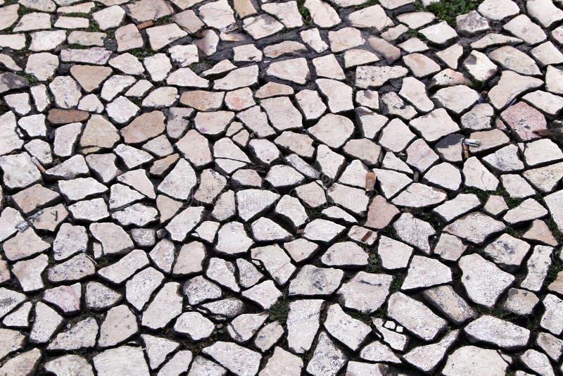 Piso pavimentado de una calle en Lisboa imágenes de archivo libres de regalías