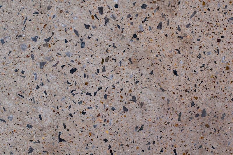 Pisos concretos de la decoración concreta del piso de la piedra con la pequeña roca pulida fotografía de archivo libre de regalías