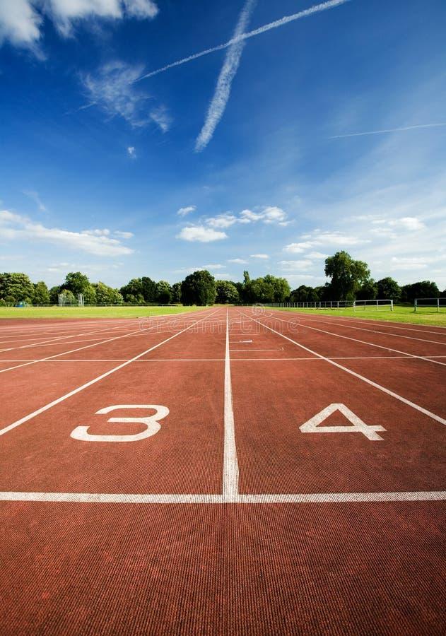 Pista corrente di atletismo immagini stock libere da diritti