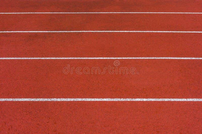 Pista corriente del atletismo directo en el estadio del deporte imágenes de archivo libres de regalías