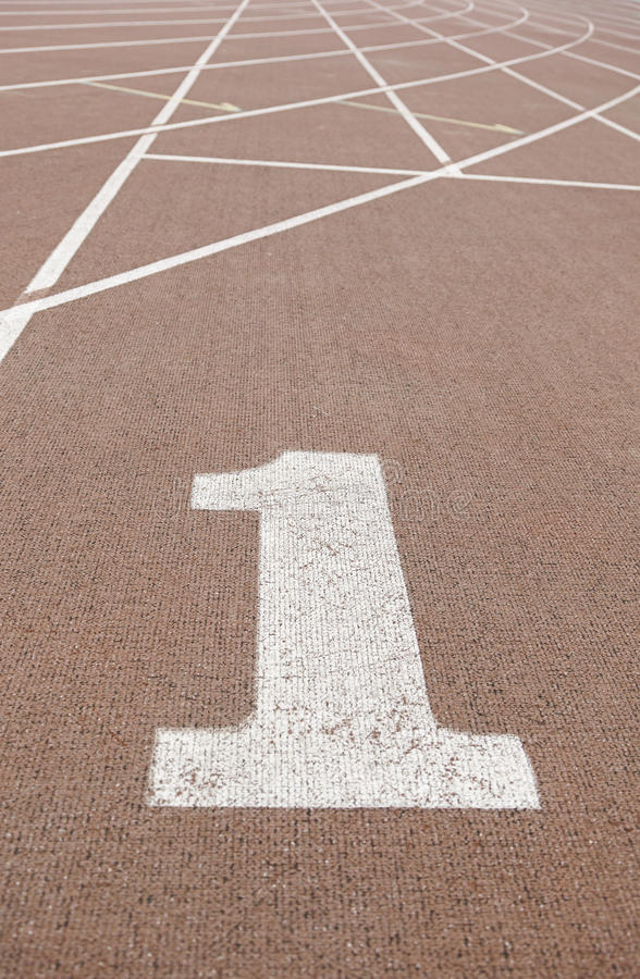 Pista de atletismo com número um foto de stock