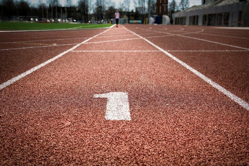 Pista de atletismo para qualquer tempo com número destacado um imagens de stock royalty free