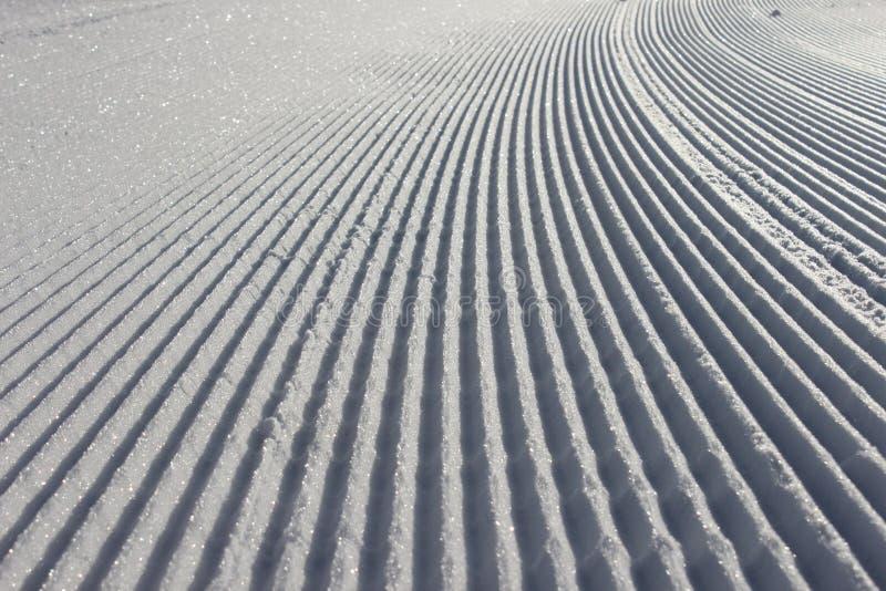 Pista de Ratrac en nieve foto de archivo
