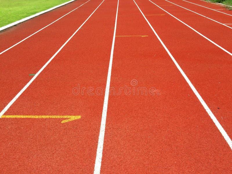 Pista pareggiante di atletica fotografia stock libera da diritti