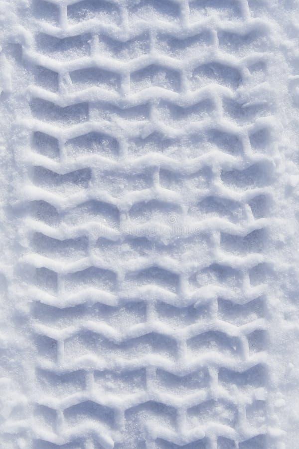 Pista pesante della gomma in neve fotografia stock libera da diritti
