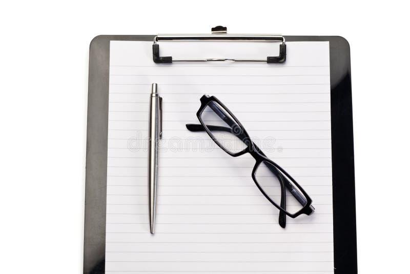 Pista, pluma y vidrios de nota imágenes de archivo libres de regalías