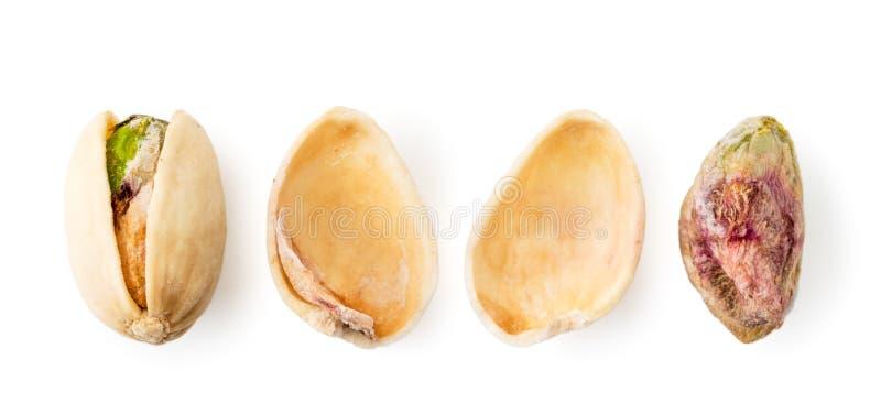 Pistache, coquille et noyau sur un blanc La forme du dessus photographie stock libre de droits