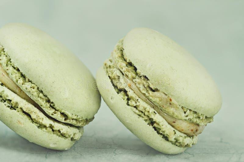 Pistache Macarons de vintage images stock