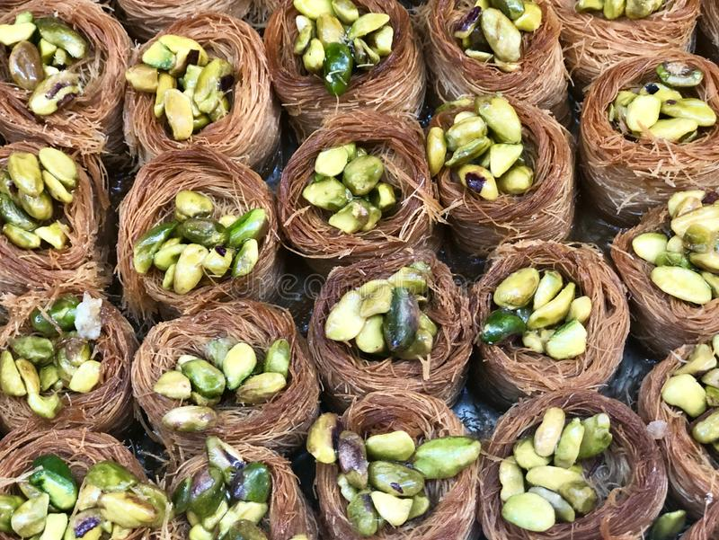 Pistachio. Baklava sweets. Traditional Arabic dessert . Kadaif noodles are a type of thin Turkish noodles. They are made ​​of flour and water that stock images