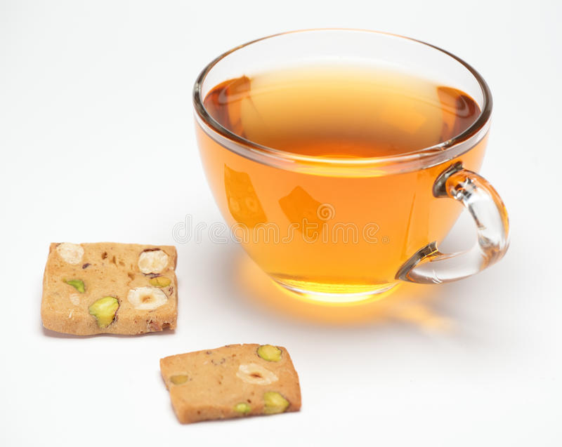 Pistachio cookies and tea. Pistachio cookies and cup of tea on white background royalty free stock image