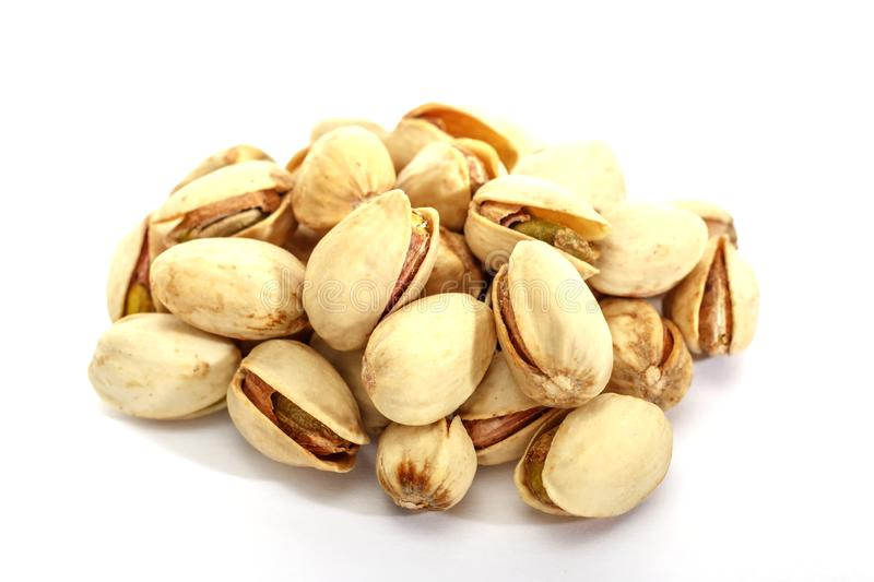 Pistachio crude on a white background. Isolated group of pistachios. Pistachio stock image