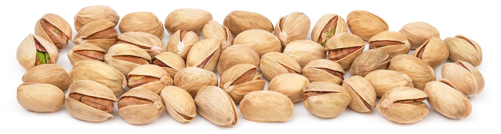 Pistachio heap isolated on white background. Pistachios close-up panorama. Nuts pile.  stock images