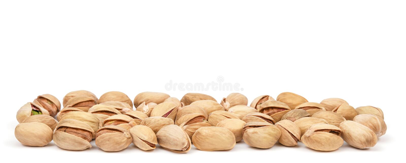 Pistachio heap isolated on white background. Pistachios panorama. Nuts pile.  royalty free stock photography