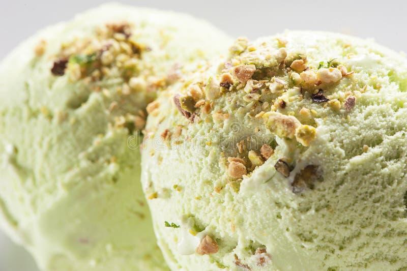 Pistachio ice cream in bowl. Scoop of pistachio ice cream in bowl stock photo