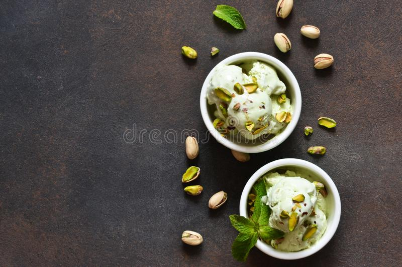 Pistachio ice cream with mint on a stone background. Green ice cream. View from above stock photo