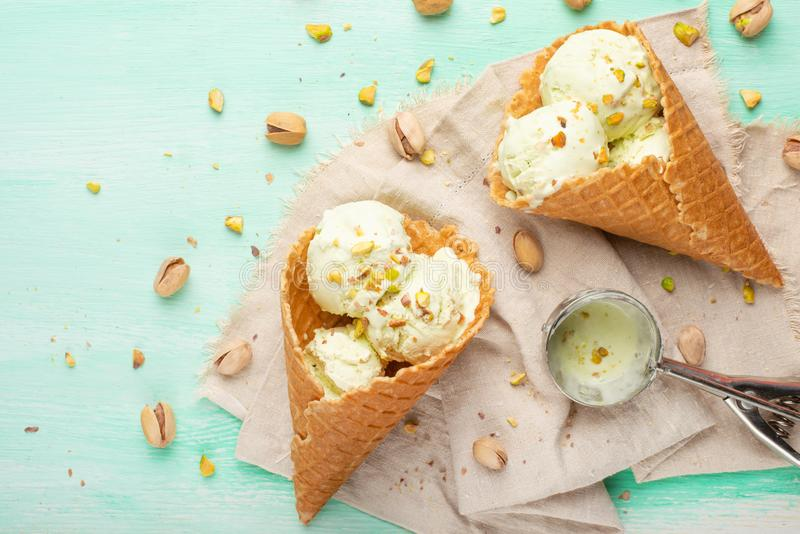 Pistachio ice cream with pistachio nuts and ice cream spoon, Top view, Flat lay.Summer mood.  royalty free stock photo