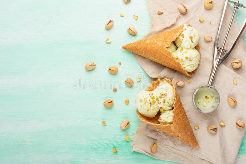 Pistachio ice cream with pistachio nuts and ice cream spoon, Top view, Flat lay.Summer mood.  royalty free stock images