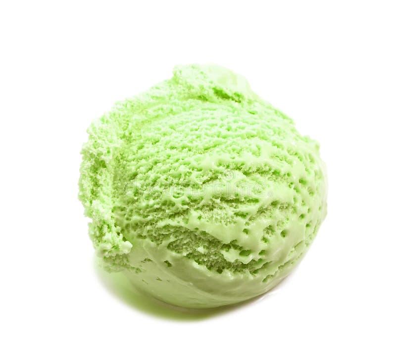 Pistachio ice cream scoop close-up isolated on white stock photo
