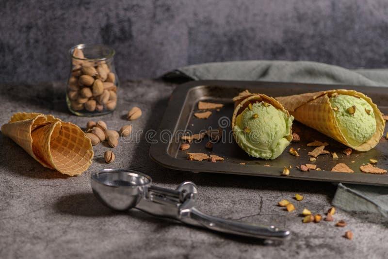 Pistachio ice cream in waffle cones stock photos