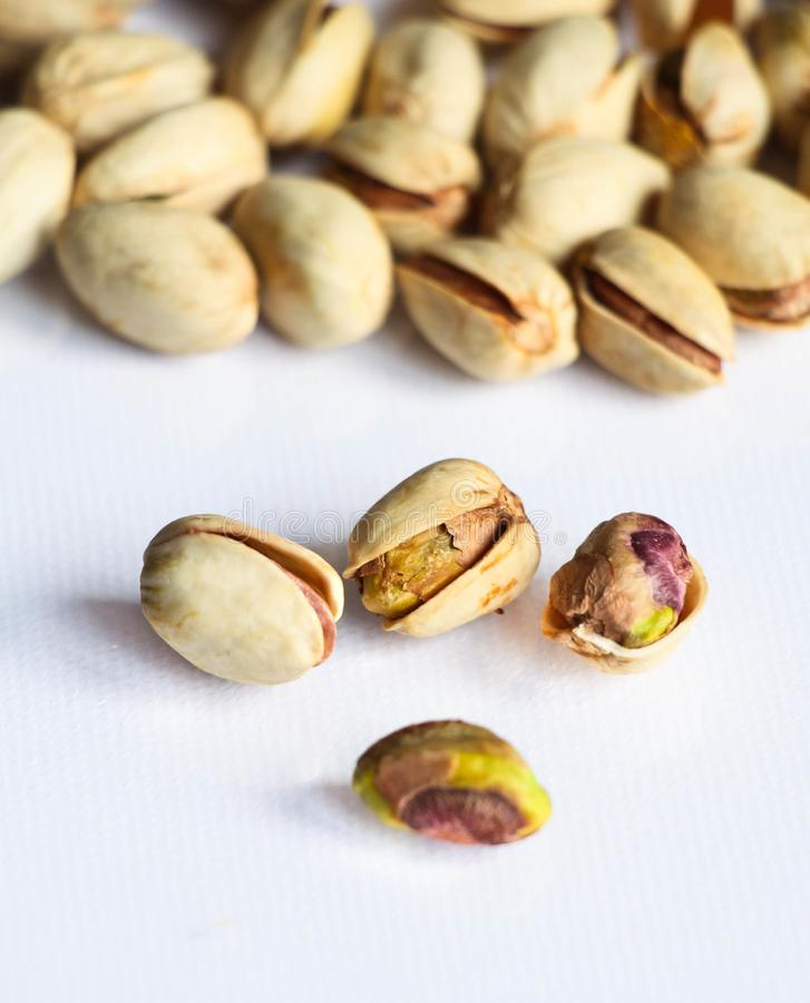 Pistachio isolated on white background with a close-up royalty free stock photos