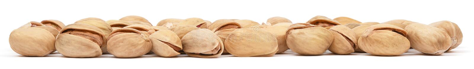 Pistachio isolated on white background. Pistachios closeup panorama. Nuts macro collection.  royalty free stock photo