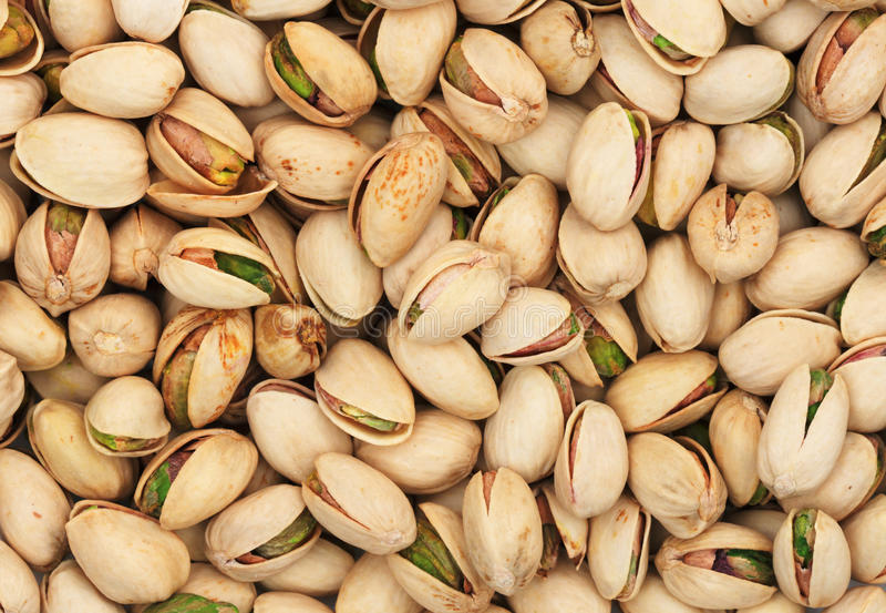 Pistachio nuts. Background of roasted pistachio nuts in their shells stock photo