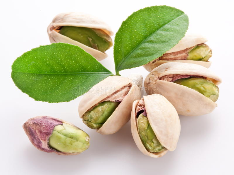 Pistachio nuts. Isolated on a white background royalty free stock photos