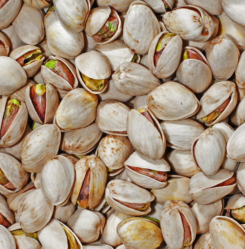Pistachio Nuts. A bowl of roasted pistachio nuts stock images