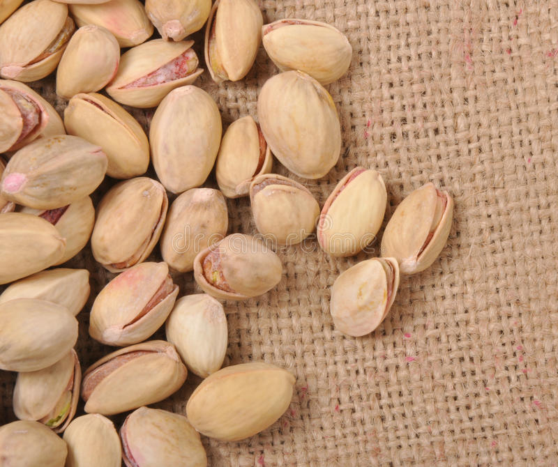 Pistachio nuts. On sack background stock images