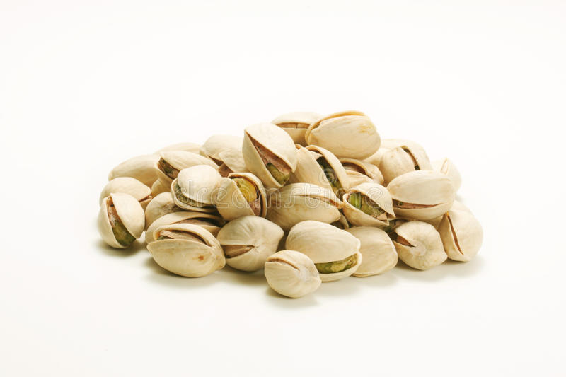 Pistachio nuts. On isolated white background royalty free stock photo