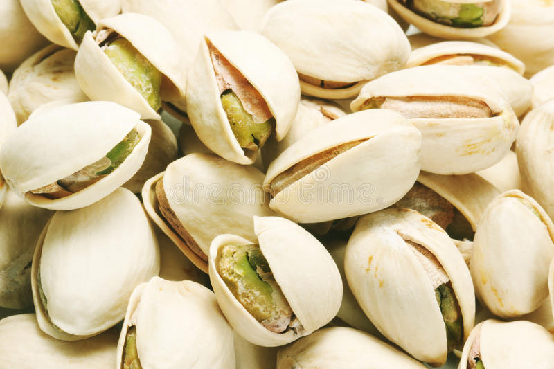 Pistachio nuts. Close up isolated royalty free stock photos