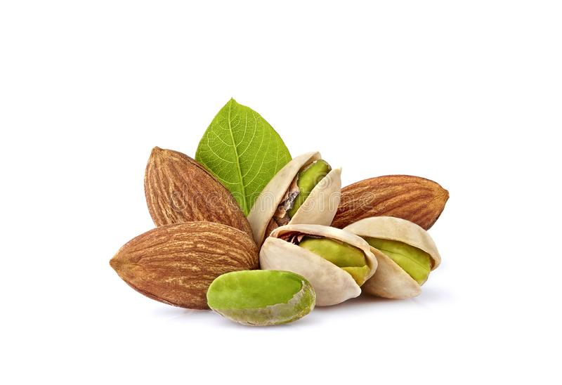 Pistachio nuts and almonds with leaves in closeup isolated. Nuts assorted royalty free stock photography