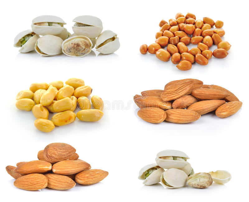 Pistachio nuts, Almonds, Peanuts on white background stock photos