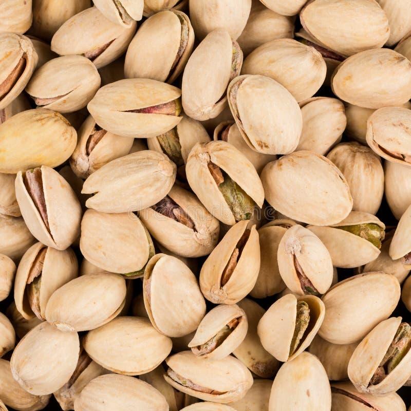 Pistachio nuts arranges as background stock images