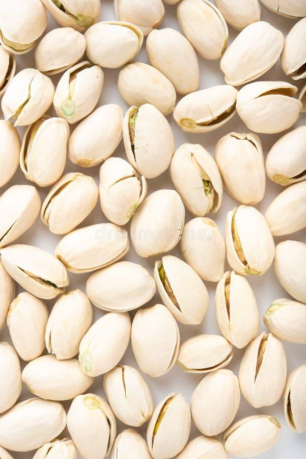 Pistachio nuts arranges as background stock photo