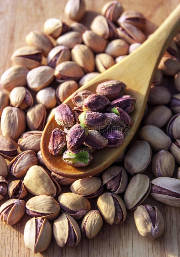 Pistachio nuts background. Pistachio nuts on wooden background stock images