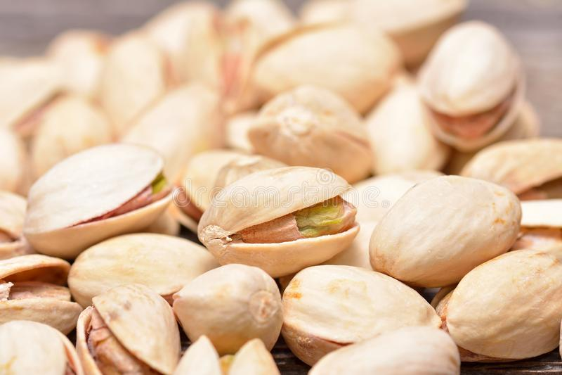 Pistachio nuts. Close up on wooden table royalty free stock images