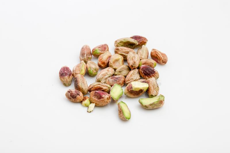 Pistachio nuts. Handful of pistachio nuts on white background stock photos