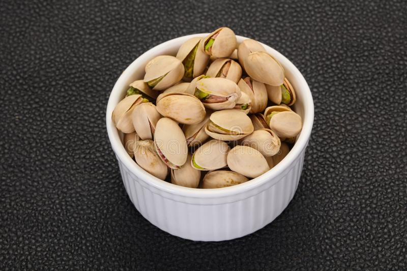 Pistachio nuts heap stock photography