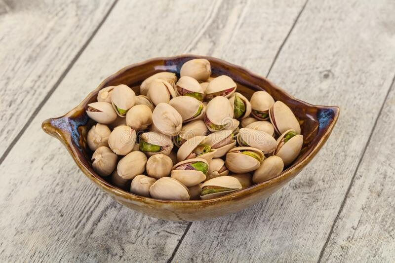 Pistachio nuts heap. In the bowl stock image