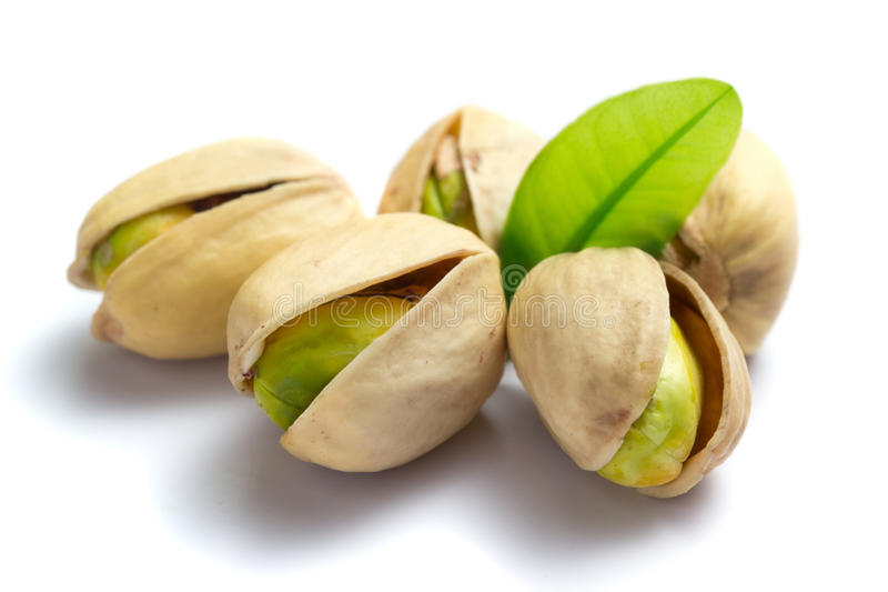 Pistachio nuts with leaf stock photography