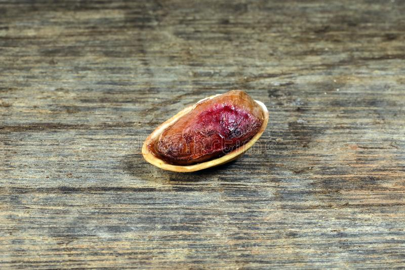 Pistachio nuts shell on rustic wood stock photos