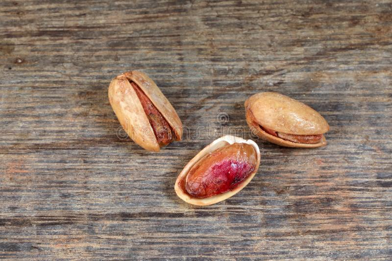 Pistachio nuts shell on rustic wood stock images
