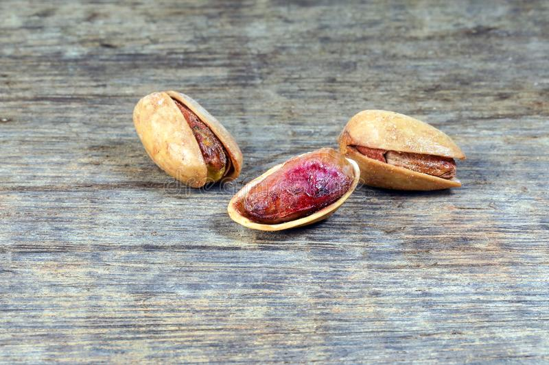 Pistachio nuts shell on rustic wood stock image