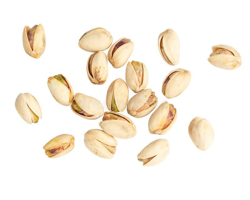 Pistachio nuts on white background.  stock photos