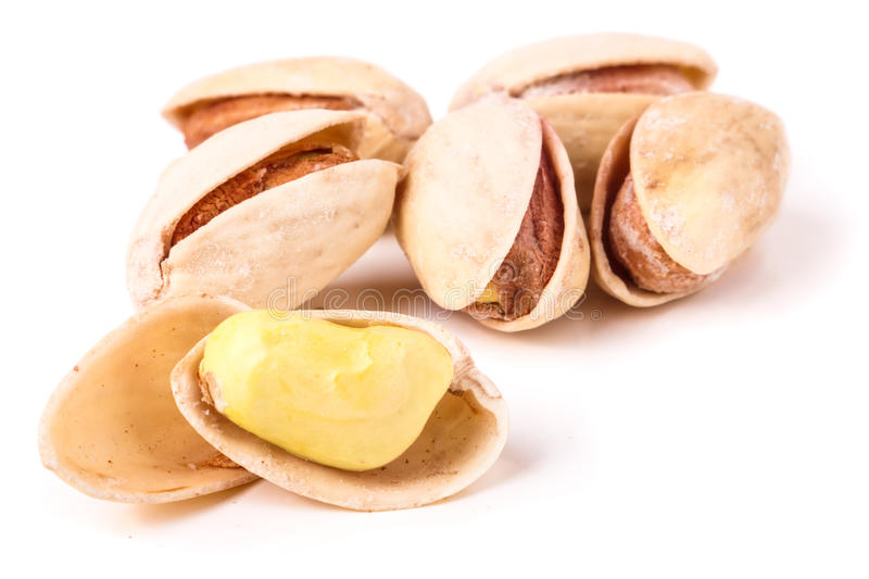 Pistachio nuts on a white background isolated stock images