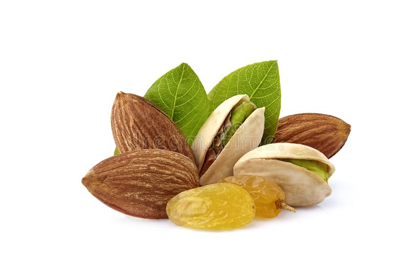 Pistachio nuts wits raisins, almonds and leaves in closeup isolated. Nuts mix royalty free stock image