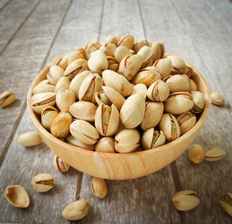 Pistachio nuts. In wood cup ,closeup stock image