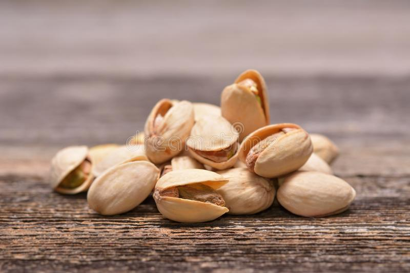 Pistachio nuts. On wooden background royalty free stock photo